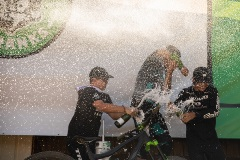 guys spraying champaign everywhere on the podium at crafts n cranks 2019