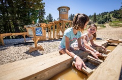 two girls looking for gems at summit mining co.