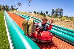 kid on a summer tubing attraction