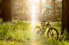 female mountain biker riding on a cross-country trail