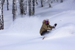 girl riding in fresh snow powder