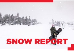 snow report, snowboarder holding a snowboard