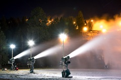 snowmaking guns turned on at night