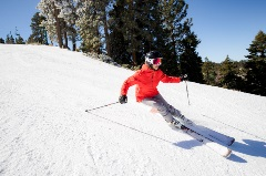lady skier riding down the hill