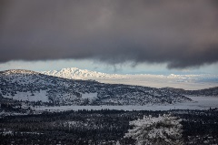 snowy scenic of big bear mountain resort from a distance