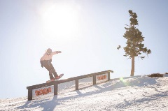 snowboarder on a feature in the snow