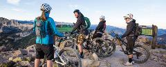 Group of mountain bikers taking a break at the Lakes Basin overlook.
