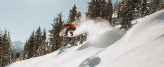 snowboarder slashing powder