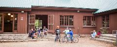 Group of adults and kids in front of the lodge at the historic Camp High Sierra in Mammoth Lakes.