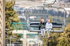 two girls taking a ride on a scenic sky chair