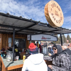 people eating at Outlaw BBQ at Bear Mountain