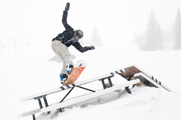 snowboarder doing a trick at adidas das table contest