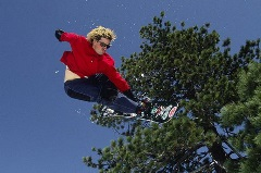 snowboarder wearing red doing a trick
