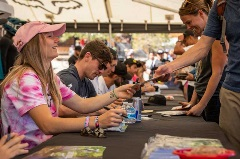 signing table with a crowd of people for the Fox US Open of MTB event