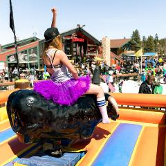 girl riding a mechanical bull at bear mountain