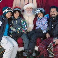 Family taking a photo with Santa