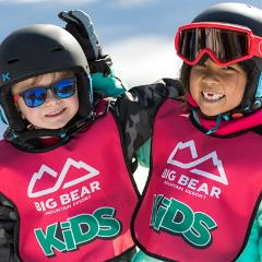 two kids taking a lesson at snow summit during the winter