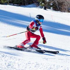 girl racing at snow summit
