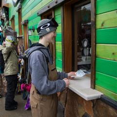guy purchasing tickets at the snow summit ticket window in the winter time