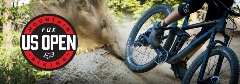 mountain biker spraying dirt from bike wheel