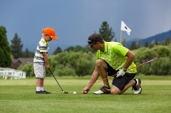 son and dad playing golf