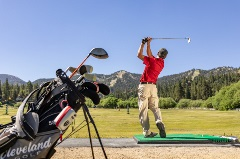 guy swinging a golf club at bear mountain golf course's driving range