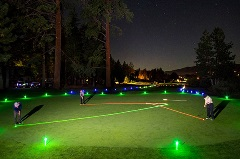 glow golf, golfing in the mountains at night