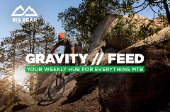 gravity feed, mountain biker riding down hill