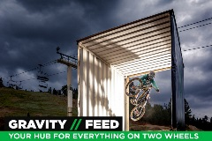 guy mountain biking through a container