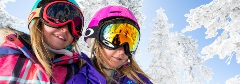 two girls with oakley goggles in the snow