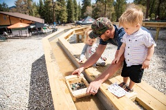 a dada and his two kids at the summit mining co. looking for gems