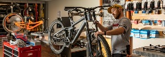 man reparing a mountain bike