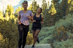 two girls running on a trail at snow summit