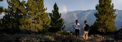 two people hiking and a rainbow