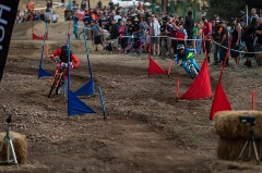 two mountain bikers competing on a dual slalom course
