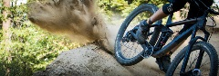 mountain biker spraying dirt with bike