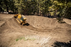 big machinery on a dirt mtb trail