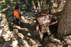 two trail crews assessing a mtb trail