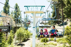 family riding the scenic sky chair at snow summit