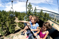 3 kids riding the scenic sky chair