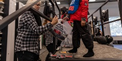 kid getting fitted for snowboard boots