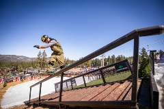 snowboarder doing a trick on a rail