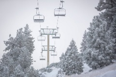 chairlifts with a snowy background