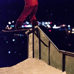 snowboarding doing a trick during night session