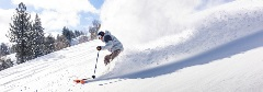 guy snowboarding in powder