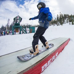 kid on the team bear training team is doing a trick with his snowboard