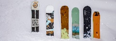 snowboards in the snow standing up