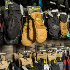 snow gloves hanging on a rack at big bear sports