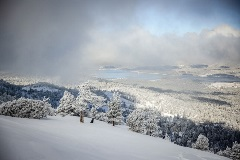 scenic view of big bear lake covered in snow from the top of the mountain