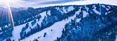 scenic view of a snowy ski resort mountaintop